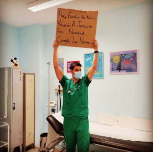 médico-levanta-cartaz